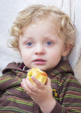 Cute Blond Boy with apple Royalty Free Stock Image
