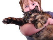 Cute blond boy with a cat, focus on cat Royalty Free Stock Photos