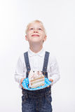 Cute blond boy is celebrating his birthday Royalty Free Stock Image