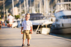 Cute blond boy with flower Royalty Free Stock Images