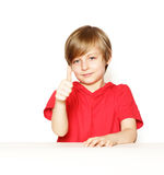 Cute blond boy in the red shirt. Over a white background Royalty Free Stock Images