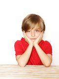Cute blond boy in the red shirt. Over a white background Stock Photography