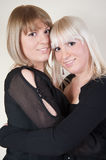 Cute blond and brunette sisters Stock Image