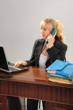 Cute blond business woman at desk Stock Image