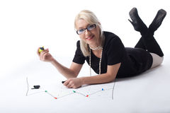 Cute blond business woman draw financial graph Stock Image