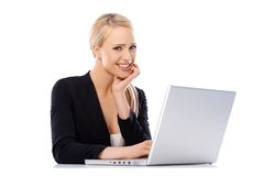 Cute blond business woman working on laptop Royalty Free Stock Photography