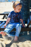 Cute blond child at the beach Royalty Free Stock Photos