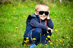 Cute blond child  with dandelions Stock Photo