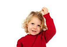 Cute blond child touching his long hair Royalty Free Stock Photography