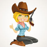Cute blond cowgirl with colt sit on floor Royalty Free Stock Photography