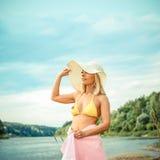 Cute blond girl in bikini and hat Stock Photo