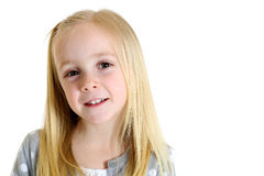 Cute blond girl with brown eyes and an endearing expression Stock Photo