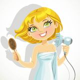 Cute blond girl dries her hair hairdryer Stock Image