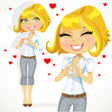 Cute blond girl folded heart out of the hands Royalty Free Stock Photography