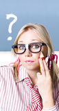 Cute blond girl in glasses asking big question Royalty Free Stock Image