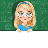 Cute blond girl in glasses holds a large white horizontal banner Stock Photo