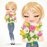 Cute blond girl holding beautiful bouquet of color tulips Stock Photos