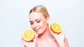 Cute Blond Girl Holding Orange Fruit stock video footage