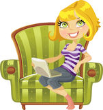 Cute blond girl with a laptop in a chair Stock Image