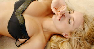 Cute Blond Girl Lying on Sand stock footage