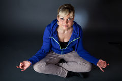 Cute blond girl in a meditation position Royalty Free Stock Photo