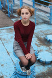 Cute blond girl on the pier. The girl on pier in a sweater Royalty Free Stock Photo