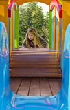 Cute blond girl  playing in a playground Stock Photo