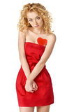 Cute blond girl in red dress with a heart Stock Photography