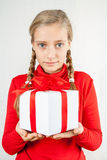 Cute blond girl in red with gift box Royalty Free Stock Photos