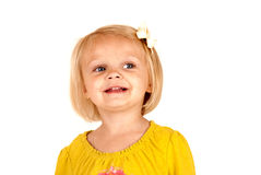 Cute blond girl smiling looking away Stock Images