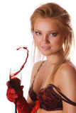 Cute blond girl with a splash of red wine isolated. Cute blond girl with a glass, splash of red wine isolated Royalty Free Stock Photography