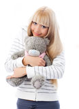 Cute blond girl with a Teddy bear Royalty Free Stock Photos