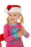 Cute blond girl wearing santa hat looking away Stock Photo
