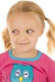 Cute blond girl wearing winter pajamas looking down Stock Images