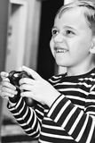 Playing video game. Cute blond   happy Child playing  Playing video game Royalty Free Stock Photos