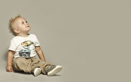 Cute blond kid looking up Stock Images