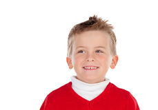 Cute blond kid with red jersey Royalty Free Stock Photography