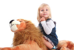 Cute blond kid with toy Royalty Free Stock Photography