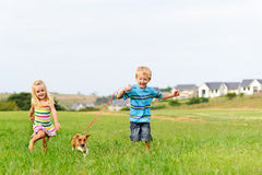 Cute blond kids running in a field Royalty Free Stock Photo