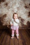 Cute blond little girl with big grey eyes and plump cheeks stock photo