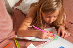 Cute blond little girl drawing  Stock Photo