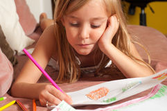 Cute blond little girl drawing on the paper Stock Images