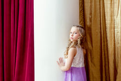 Cute blond little girl posing looking at camera Royalty Free Stock Photo