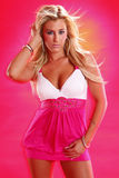 Cute blond on pink Stock Images