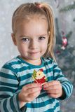 Cute blond preschool girl decorating christmas tree. Authentic family xmas time stock photos