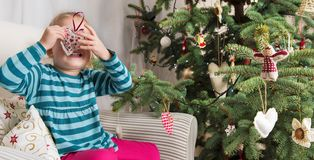 Girl decorating christmas tree. Authentic family xmas time concept Stock Images