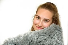 Pretty teenage girl cuddling with pillow stock images