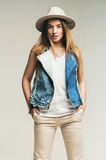 Cute blond woman in hat and denim waistcoat Stock Image