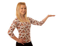 Cute blond woman pointing into copy space as she is showing a pr. Oduct for commercial Royalty Free Stock Photography