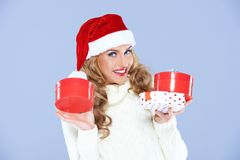 Cute blond woman in a Santa hat Stock Photography